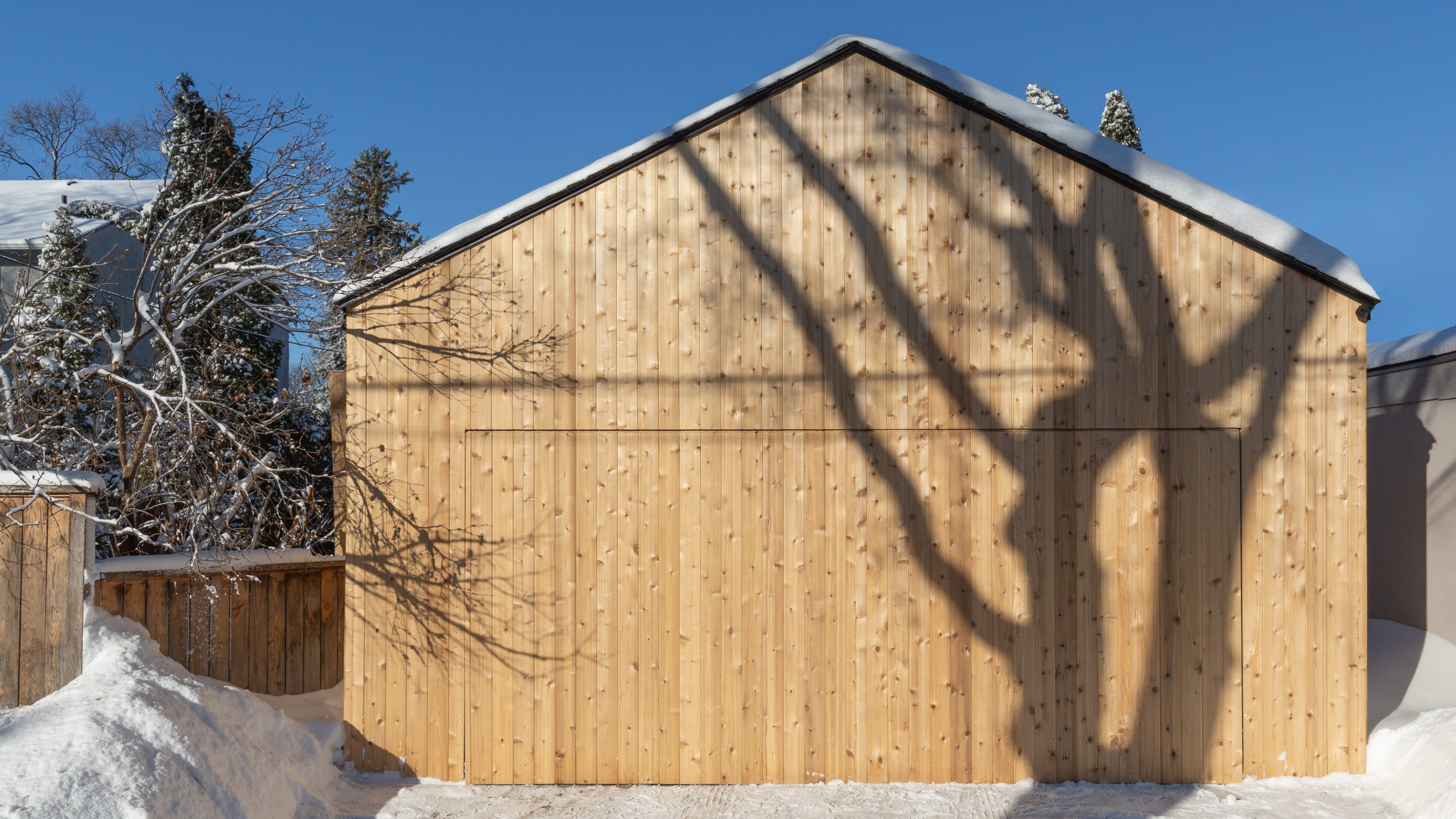 The result, with custom-built (mostly) hidden one-piece garage door